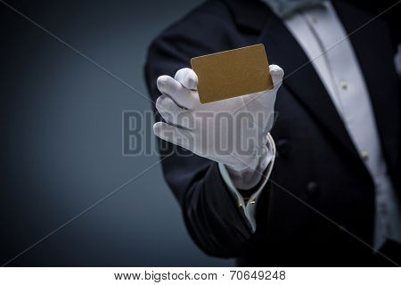 Man in a tuxedo with credit card