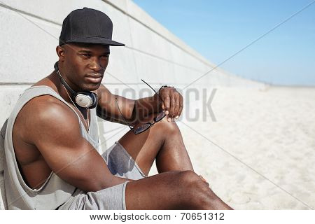 Young African Man Relaxing On The Beach