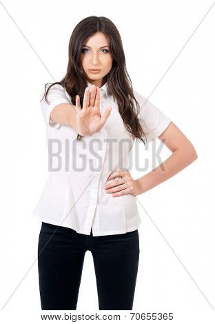 Young woman holding up her hand to say stop, isolated on white background