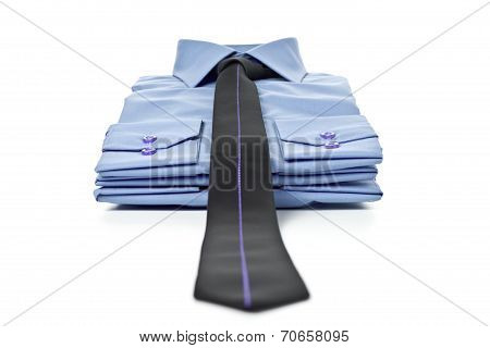 Stack of blue man's shirt and tie