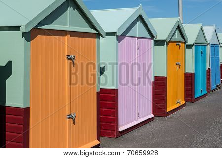 Row Of Beach Huts In Sunshine