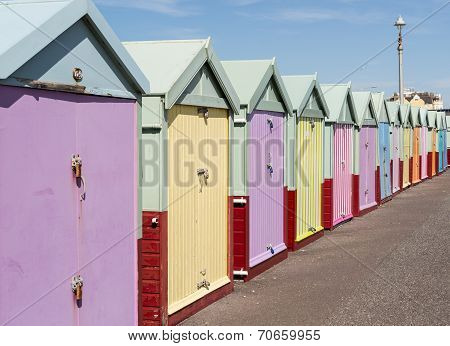 Colourful Beach Huts In Bright Sunshine