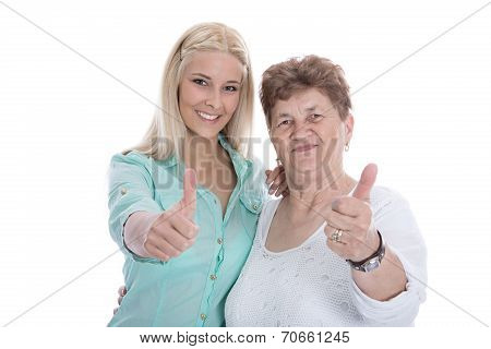 Isolated Portrait Of Happy Grandmother And Granddaughter With Thumbs Up.