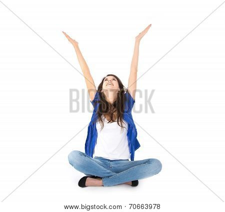 Isolated Young Woman With Hands Up Sitting In Crossed Legs On The Floor