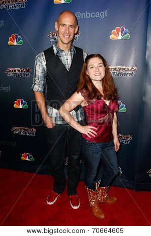 NEW YORK-AUG 20: Andy Cook (L) and Abigail Baird of Aerial Animation attend the post-show red carpet for 'America's Got Talent' Season 9 at Radio City Music Hall on August 20, 2014 in New York City.