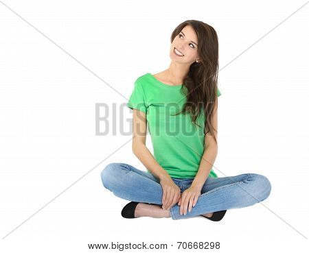 Isolated Young Woman Sitting In Crossed Legs On The Ground.