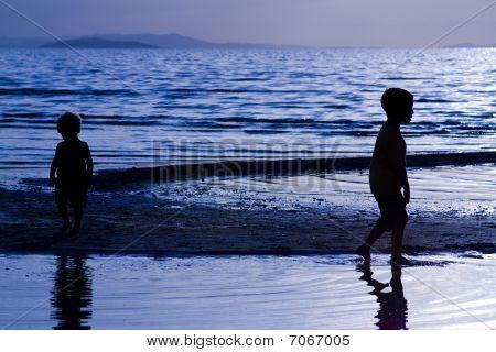 Kids Playing On Te Beach