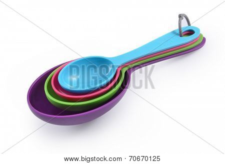 plastic measuring spoons isolated on white background