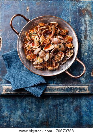 Shells Vongole With Parsley And Tomato Sauce On Blue Background