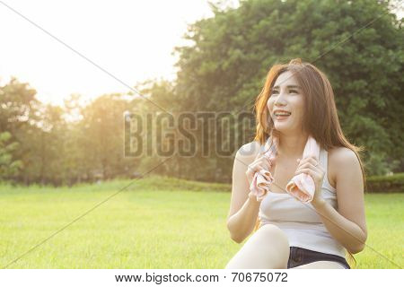 Woman Sitting After Jogging.