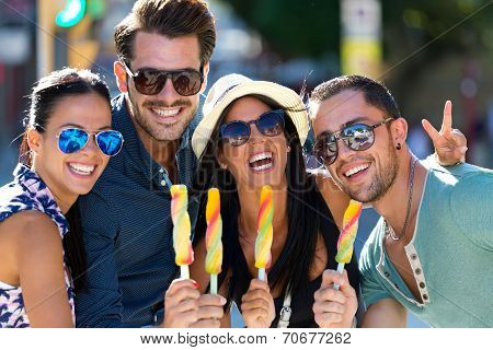 Portrait Of Group Of Friends Eating Ice Cream.