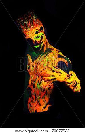Body art glowing in ultraviolet light -  Fire