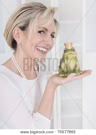 Single Attractive Older Woman With A Frog King In Her Hands.