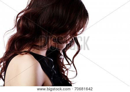 Side portrait of a beautiful woman with curly hair