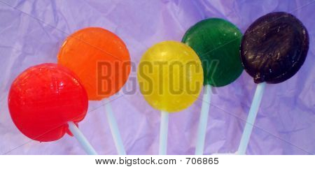 Lollipops On A Purple Background