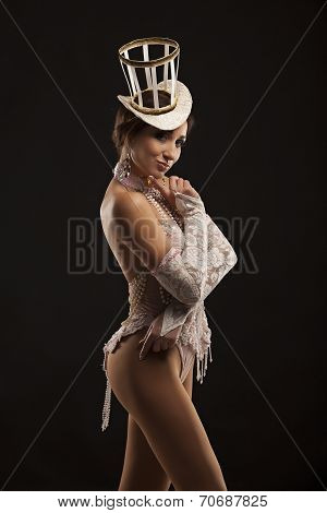 Burlesque dancer in white dress with hat