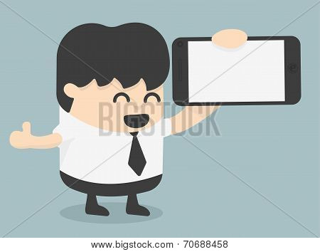 Businessman Showing A Blank Smart Phone Screen With Thumbs Up