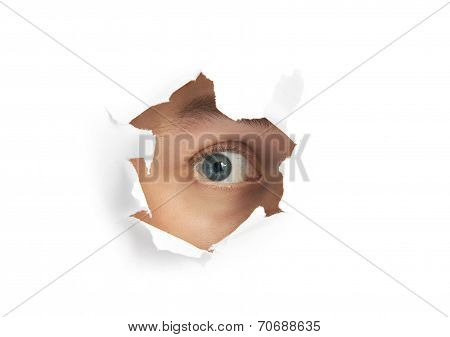 Eye looking through a hole