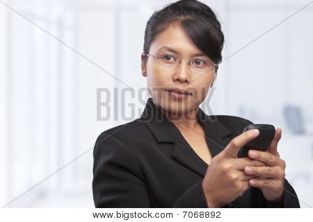 Asian Businesswoman Looking At Blank Space