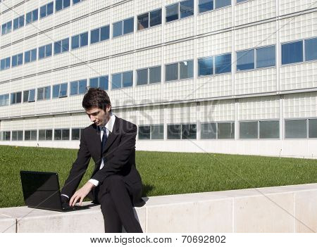 Young Manager Working Outdoors