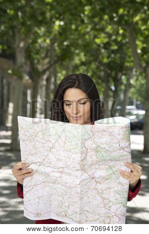 smiling woman looking at a map