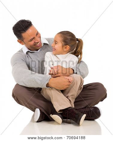 happy daughter sitting on father's lap isolated on white background