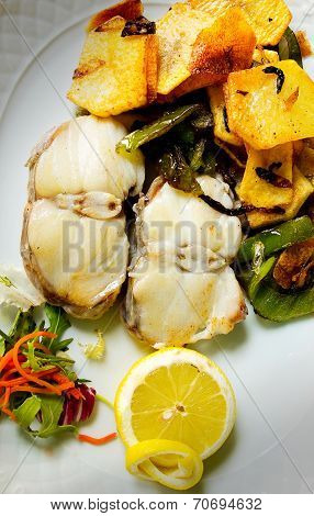 Grilled Hake With Potatoes And Green Peppers.