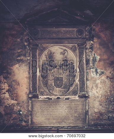 Coat of arms and old text on memorable wall