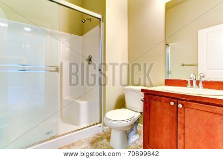 Simple Bathroom Interior With Vanity Cabinet And Glass Door Shower