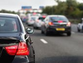 stock photo of tail  - Rush hour traffic congestion focus on tail brake light - JPG