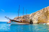 picture of sailing vessels  - Vintage sailing boat anchored in an idyllic bay on Krk island in Croatia in Mediterranean sea - JPG