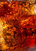 stock photo of coca-cola  - Cola in glass with ice and a bubbles of gas - JPG