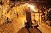 pic of gold mine  - Underground mine tunnel mining industry with train cart - JPG