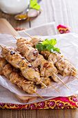 stock photo of bast  - Chicken kebabs with yogurt and spices marinade