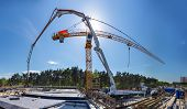 stock photo of concrete pouring  - Concreting the grillage of the bridge panorama - JPG