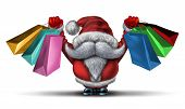 picture of christmas claus  - Christmas shopping spree as a fun Santa clause with a white beard and a red snow costume holding retail gift bags for holiday buying fun and joyous winter sale holiday celebration on a white background - JPG