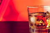 pic of whiskey  - whiskey glass with ice on bar table lounge bar atmosphere with space for text - JPG