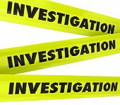 stock photo of crime scene  - Investigation word on yellow police crime scene tape to secure an area where detective work is taking place - JPG