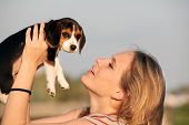 pic of shy woman  - woman owner with pet beagle dog - JPG