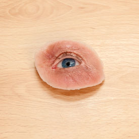 foto of eye-sockets  - Synthetic Eye and Skin for Destroyed Eye Sockets on Wooden Table - JPG