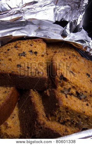 Slices Of Zucchini Bread In Aluminum Tray