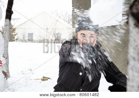 Man Throwing A Snowball