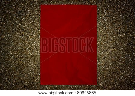 Red Paper On Stone Wall