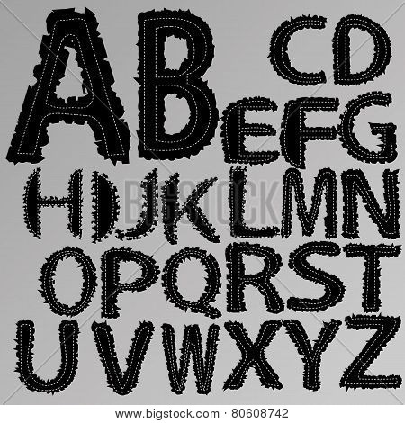 Vector alphabet with torn edges.