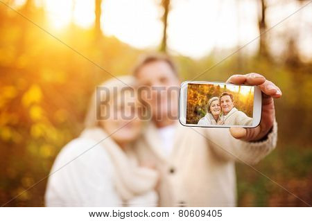 Active seniors taking selfies of themselves