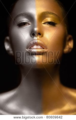 Girl with gold and silver glitter skin. Art image beauty face.