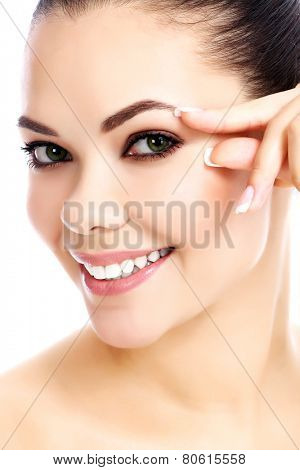 Portrait of beautiful woman pinching skin on her face, white background, isolated