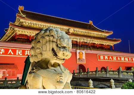 BEIJING, CHINA - JUNE 27, 2014: A lion statue guards The Tiananmen Gate at Tiananmen Square.