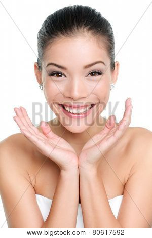 Happy beautiful young asian woman holding face to show youth and happiness. Beauty concept.