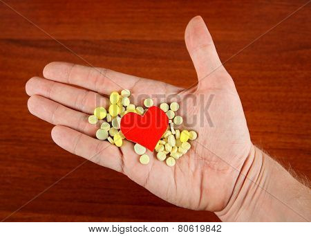 Pills And Heart Shape On The Hand